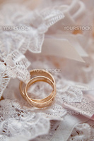 Wedding rings on white lace
