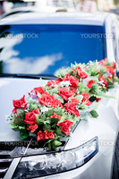 Wedding car decoration by bunch of roses