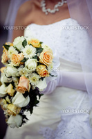 Cascade wedding bouquet with roses in bride hands