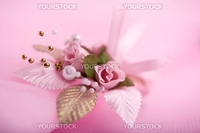 Wedding floral buttonhole on pink background