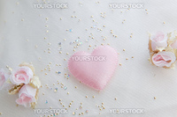 Textile white wedding background with roses and pink heart
