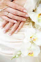 Bridal hands with french manicure and wedding ring