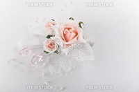 Wedding floral buttonhole with pink roses on white background