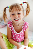 Portrait of a funny smiling child