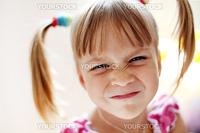Portrait of a funny child making grimace