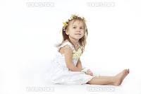 Baby girl sitting on white  background