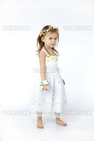 Little girl in spring flower dress isolated on white background full-length