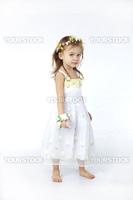 Little girl in spring flower dress isolated on white background full-length
