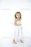 Little girl in spring flower dress on white background full-length