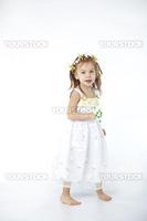 Little girl in spring flower dress on white background full-length