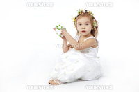 Little girl in spring flower dress isolated on white background