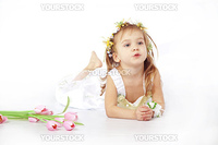 Little girl in spring flower dress on white background with tulips