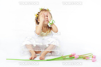 Funny baby girl playing on white backgorund