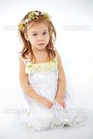 Little girl in spring flower dress on white background