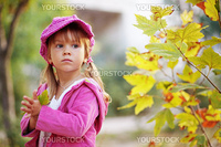 Funny fashion child walking in autumn park
