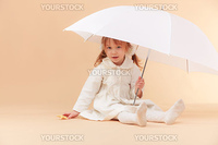 Studio shot of nice little girl with umbrella