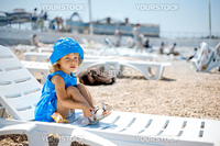 Cute child resting on beach in summer vacation