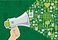 タイトル:Hand holding a megaphone promotel eco friendly icons over green background. Vector file available.