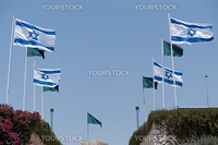 The white-blue national flags of Israel blowing in the wind.
