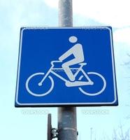 Bike lane traffic sign over blue sky