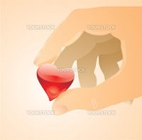 Little glass heart between two fingers.Care concept.