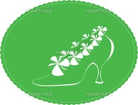 green shoes with white flowers on green