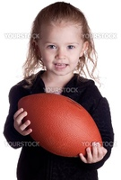 A child is holding a football asking the viewer if they would like to play too.