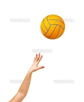 Hand and yellow ball on white background