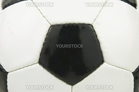 Close up shot of a black and white leather football