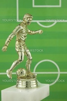 Close up shot of a gold plastic football player trophy
