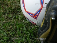 a soccer cleat on the ball ready to kick