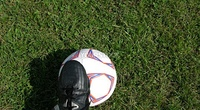 Foot on a soccer ball