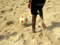Beach football on sandy beach