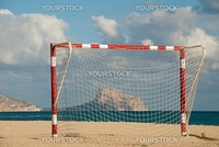 Beach football goal framing Calpeツエs landmark rock