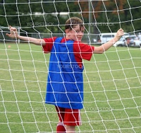 Soccer player in the net of the goal.