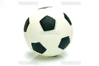 A soccer ball isolated against a green background