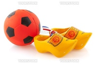 Dutch soccer with ball and wooden clogs