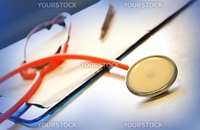 Close up of a red stethoscope, medical image