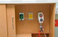 Hospital Air, Oxygen and Vacuum mounted to a cabinet.
