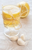 mugs with chamomile tea, garlic and  lemon