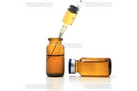 Syringe, glass bottles with drugs isolated on white