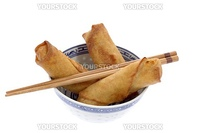 Vegetable filled Chinese spring rolls in a bowl.