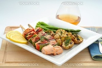 Grilled salmon on skewers with vegetatbles and potato.