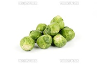 Small pile of raw green sprouts on a reflective white background