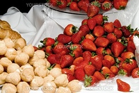 Fresh strawberries and delicious cream filled lemon puffs.