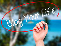 Man Hand writing Blog Your Life with black marker on visual scre