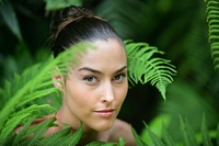 Portrait of a young woman surrounded by ferns