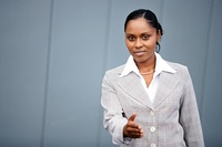 Portrait of a woman in business suit Metis preparing to shake the hand of a pers