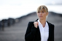 portrait of woman in business suit looking away