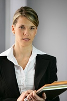 woman in business suit with documents